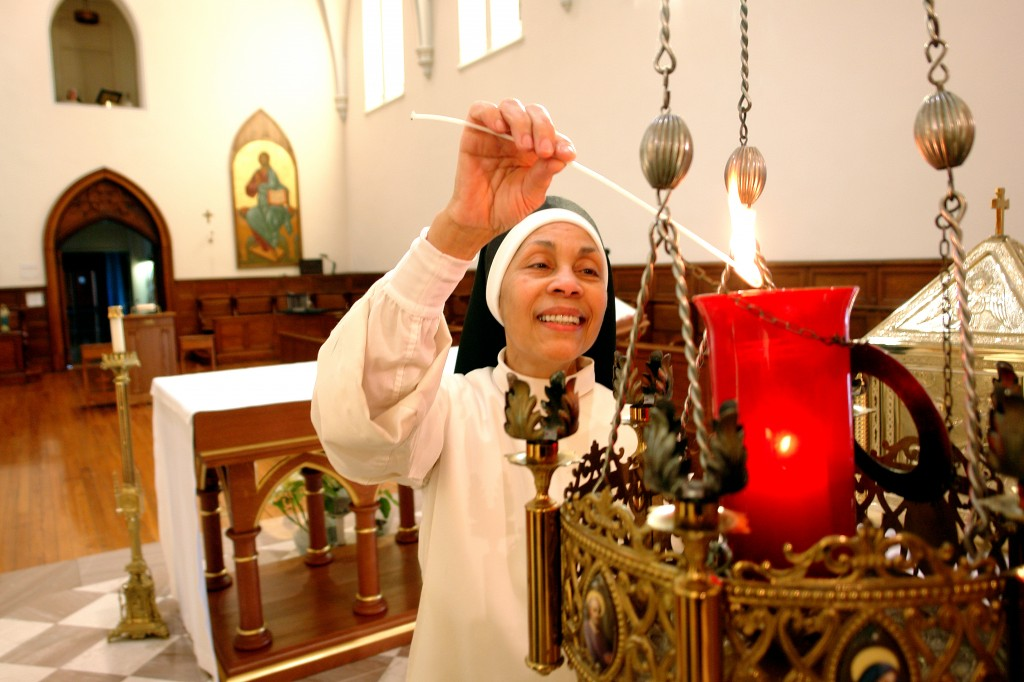 Sister Maria Faustinita Lighting candle for prayers.