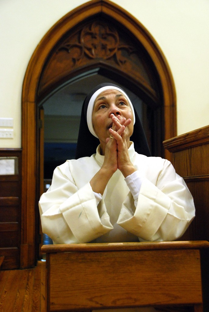 Sister Maria Faustinita praying during Adoration